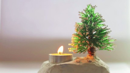 Souvenir tree and candle on a white background