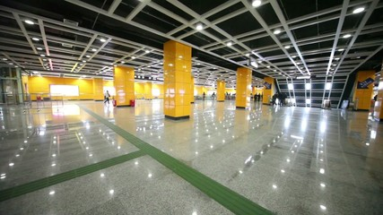 Hall subway station with pillars and lamps with reflection in the floor