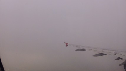 Plane flies highly over Earth and clouds, time lapse