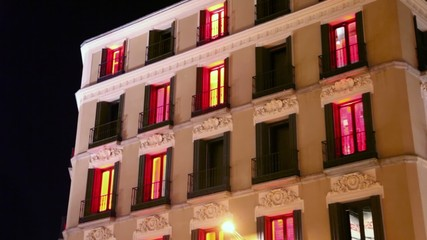 Color illumination blink in windows of hotel at night