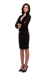 Attractive young businesswoman standing with her arms crossed