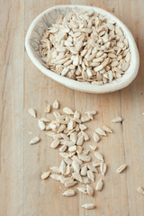 hulled sunflower seeds on wooden rustic background