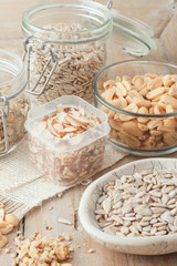 various nuts and seeds on wooden background