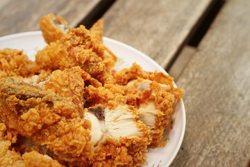 Fried chicken on a white plate on a table