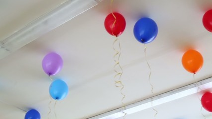 balloons inflated with helium at the ceiling at the party