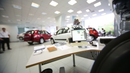 hall with table and computer in office of shop selling cars