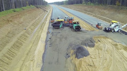 Construction of new asphalt road in summer day