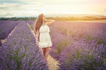Beautiful girl smiling sunlight in lavender field