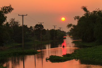 Sunset over the canal in rural of thailand