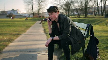 Student finish talking on cellphone and doing serious look