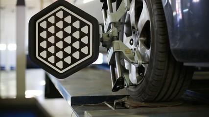 Diagnosis and wheel balancing of lifting car at Service station