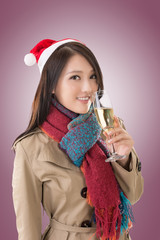 Smiling Asian woman hold a  glass of champagne