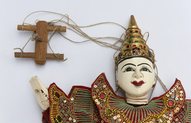Burmese puppet with rope on white background