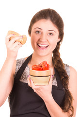 beautiful young girl eating fresh tomatoes
