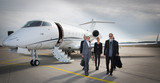 Fototapety executive business team leaving corporate jet