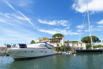 Yacht is docked at the pier in Port Grimaud, French Riviera