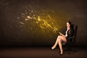 Businesswoman with tablet and energy explosion on background