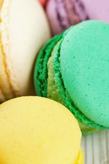 colorful macarons on wooden surface