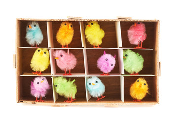 Toy chickens in wooden box