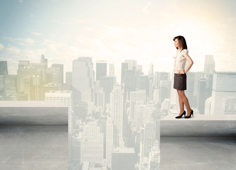 Businesswoman standing on the edge of rooftop