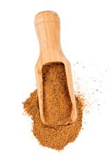 ground nutmeg in a scoop