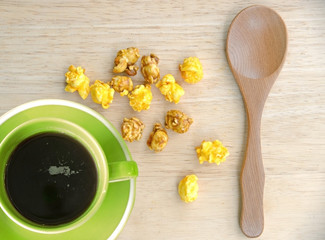 black coffee and popcorns top view.