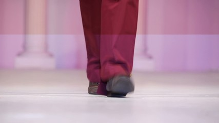Model walks the runway, shoes close-up  in fashion house