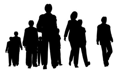 Silhouette of several people walking forward