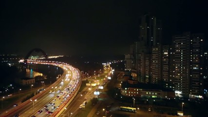 Cityscape with Zhivopisny Bridge, car traffic and tall buildings