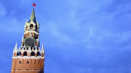 Red star on spire of Spasskaya tower with thirty two minutes past nine at clock in Moscow