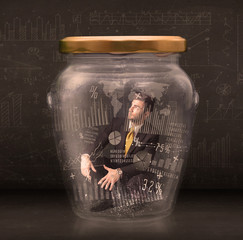 Businessman traped in jar with graph chart symbols concept