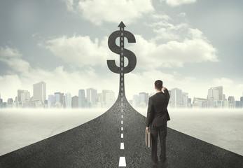 Business man on road heading toward a dollar sign