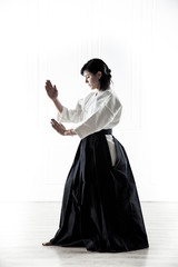 beautiful woman practicing Aikido