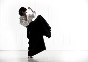 beautiful woman wearing a hakama engaged in Jiu Jitsu
