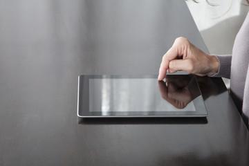 finger on tablet screen