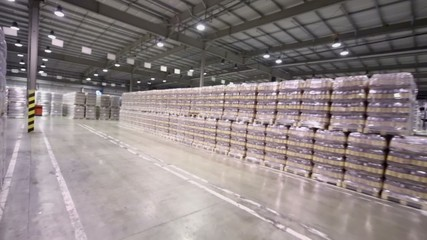 Many stacks with packaged beer in warehouse of brewery factory