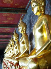 repetition golden Buddha in the temple
