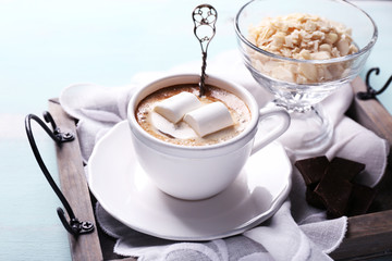 Hot chocolate with marshmallows in mug,