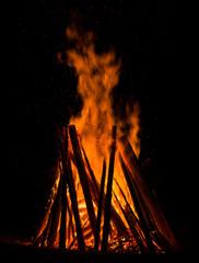 Big bonfire against dark night sky.  Fire flames