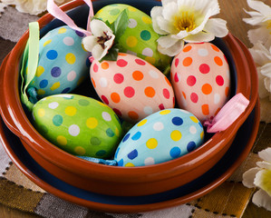 Colorful Easter eggs on  a wooden background