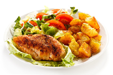 Fried chicken fillet, boiled potatoes and vegetable salad