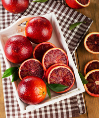 Fresh blood oranges in  white wooden box. Top view