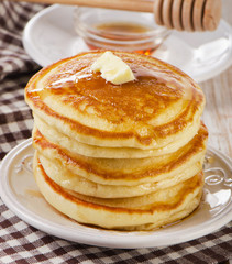 Stack of Small pancakes with maple syrup