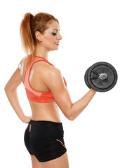 Young fit woman with dumbbells