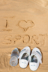 sign I love sport  in sand
