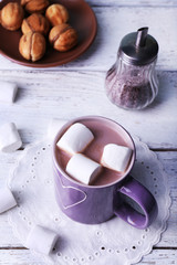 Cup of cocoa with marshmallows and cookies