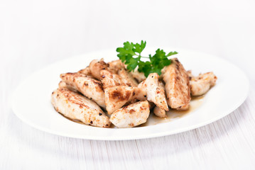 Chicken meat sliced on white plate