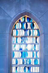 Blue and White Stained Glass in Arched Window