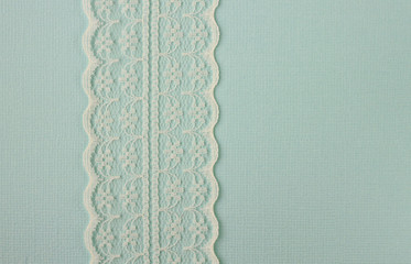 Lace on blue paper background frame