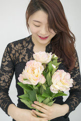 Asian woman with bouquet of flowers
